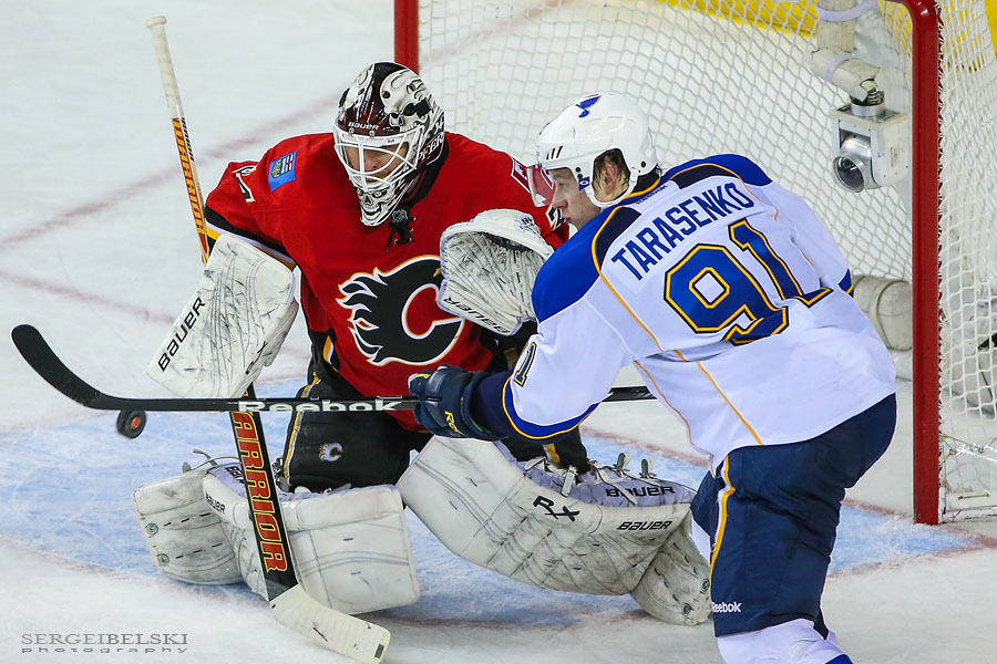 nhl hockey calgary flames vs st. louis blues sergei belski photo