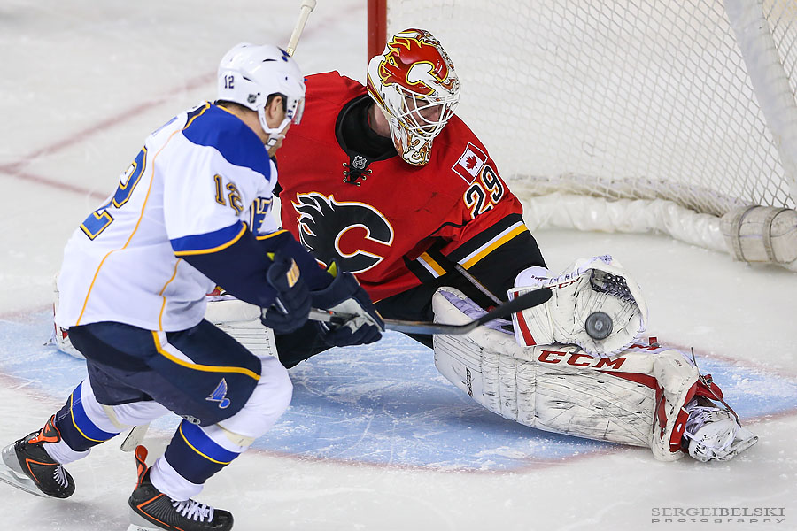 nhl hockey calgary flames vs st.louis blues sergei belski photo