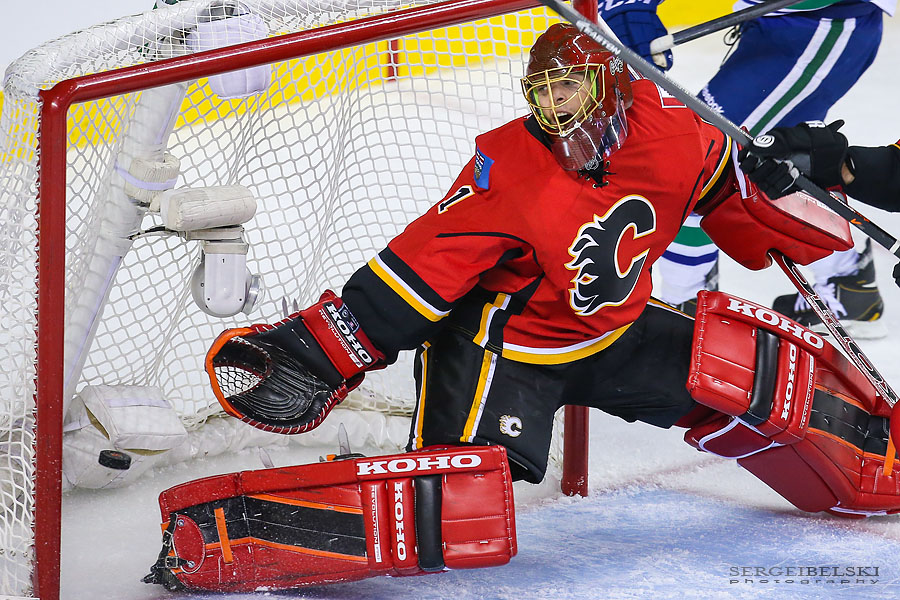nhl hockey calgary flames vs vancouver canucks sergei belski photo